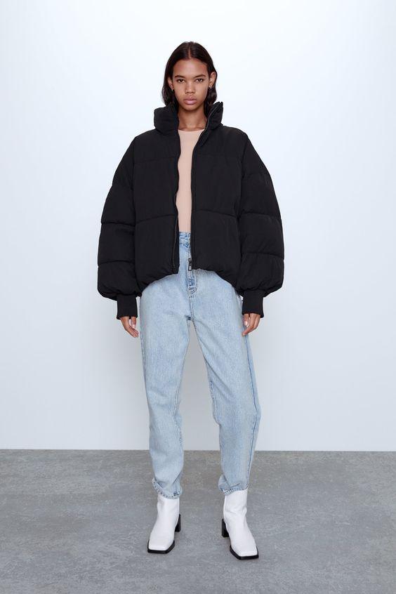 Áo khoác phao hở phối cùng quần jean